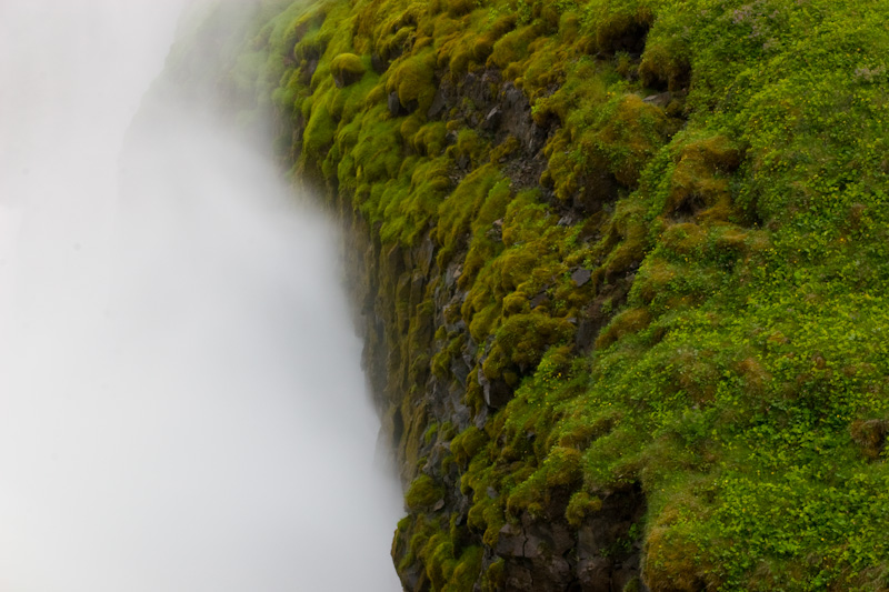 Spray From Gullfoss On Moss Covered Canyon Wall