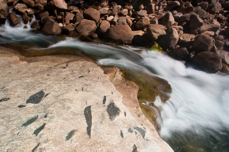 Water Flowing Over Rocks In The Merced River