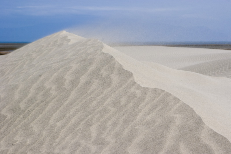 Wind Blowing Sand Over Crest Of Dune