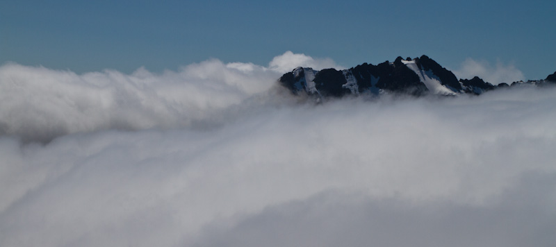 Johannesberg Mountain Jutting Out Of Clouds
