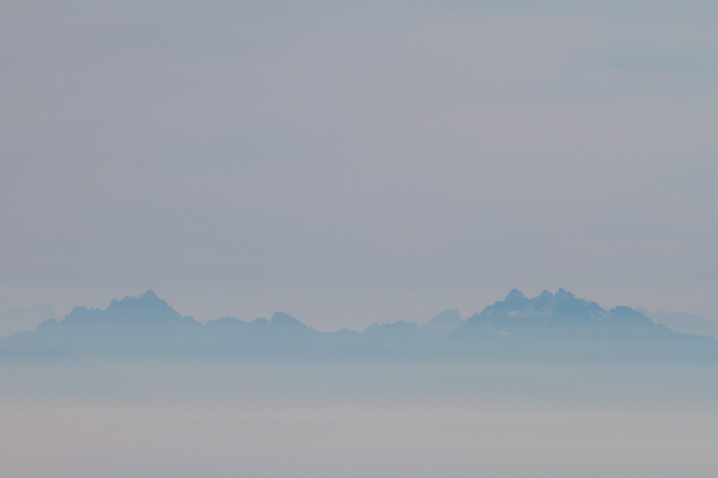 The Cascade Range In Clouds