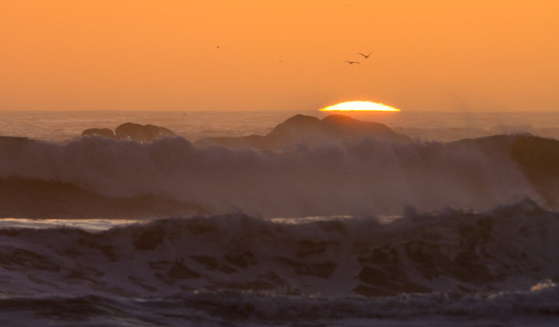 Sun Setting Behind Waves
