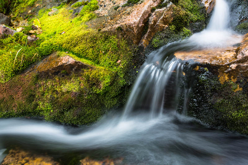 Small Cascade And Moss Covered Rock