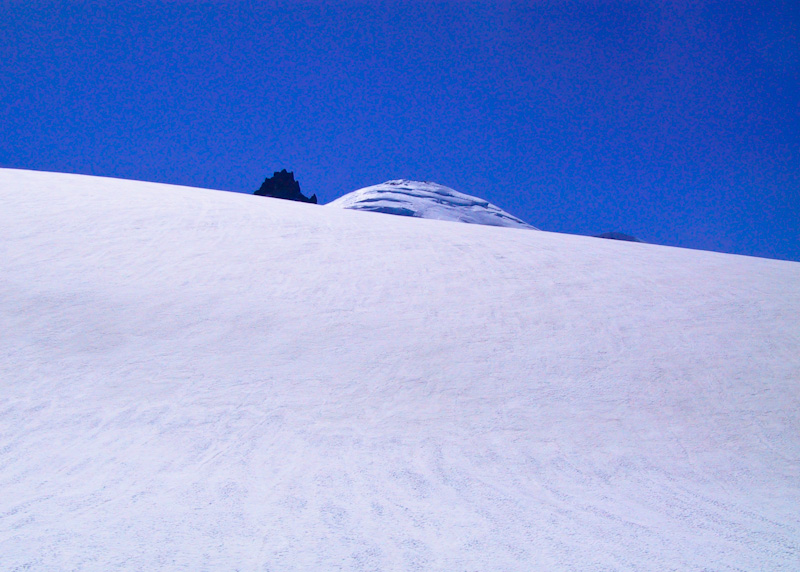 Summits Of Little Tahoma And Mount Rainier Above Snow Slope