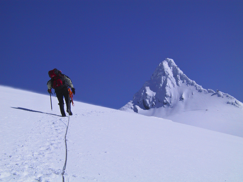 Climber Ascending Sulphide Glacier Toward Summit Pyramid Of Mount Shuksan
