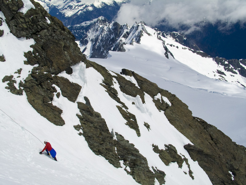 Climber Ascending The Summit Pyramid Of Mount Shuksan