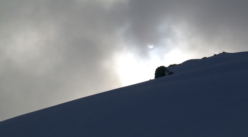 Sun Through Clouds Above Ridgeline